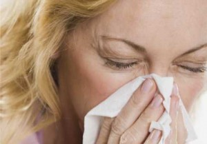 woman sneezing with hayfever