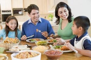 family-eating-at-dinner-table