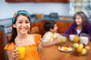 little-girl-drinking-orange-juice