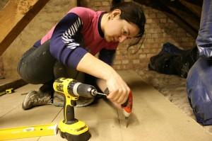 woman-installing-loft-insulation
